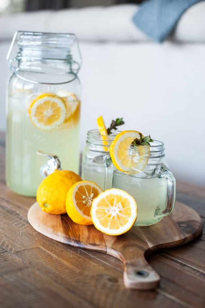 glasses of lemonade on wooden tray