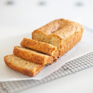 close up of sliced banana bread on wire rack