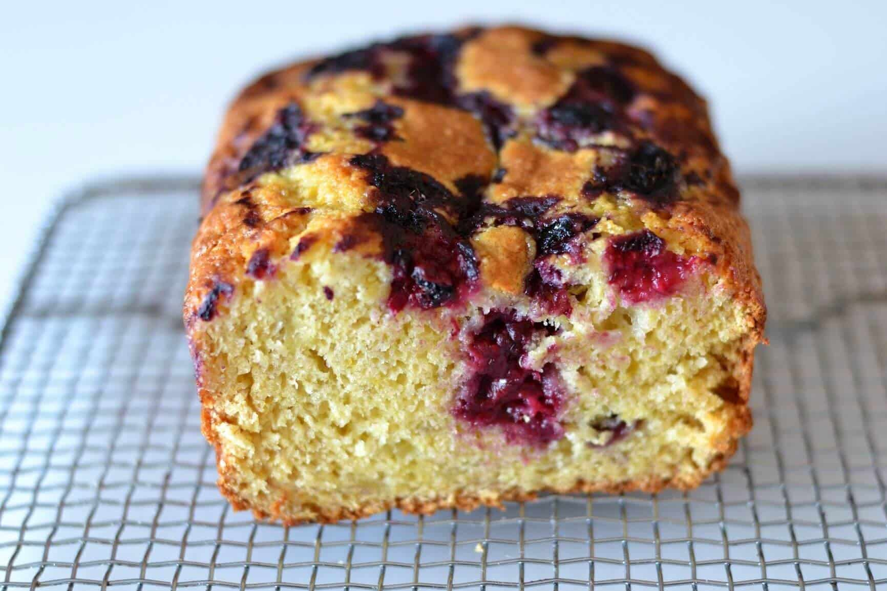 close up of sliced banana bread with berries