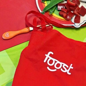 red apron and kids knife on red and green background
