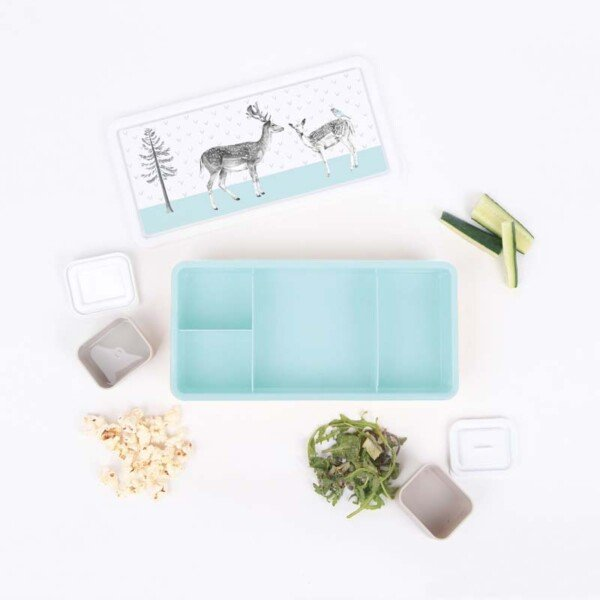 top view of a blue bento box with accessories