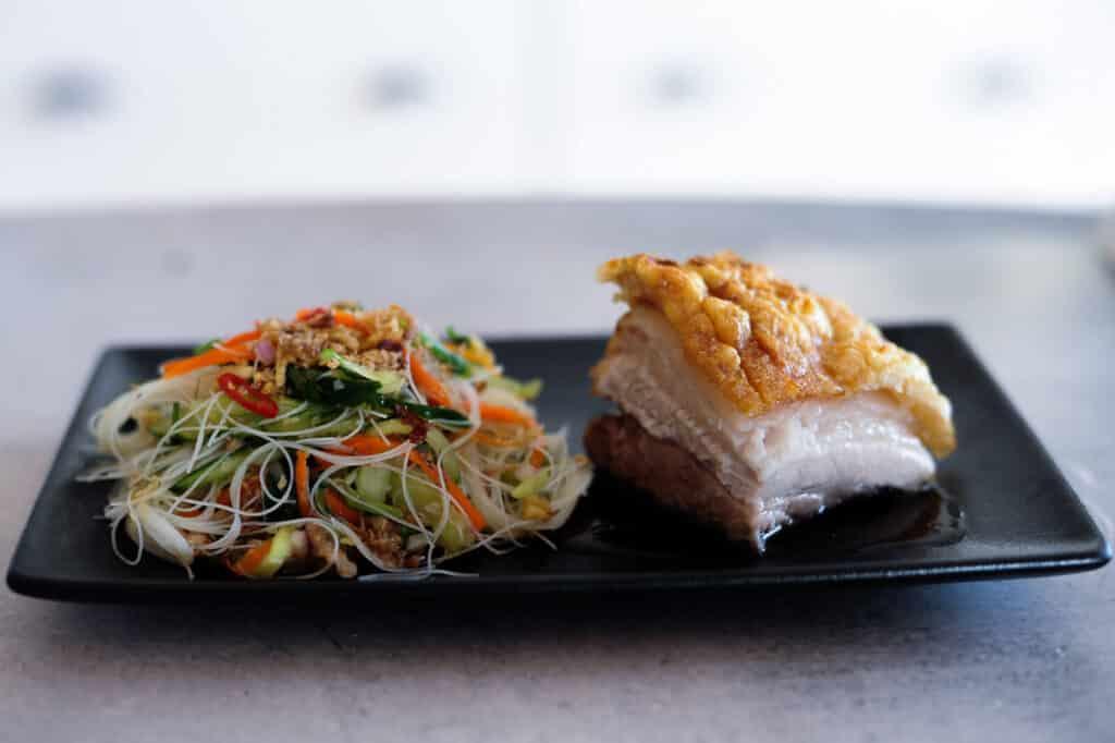 pork-belly-and-asian-noodle-salad-on-black-plate