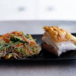 pork-belly-and-asian-noodle-salad-on-black-plate