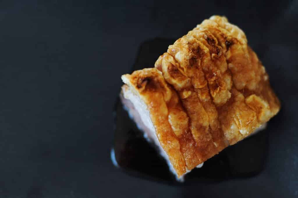 pork-belly-and-crackle-on-black-plate
