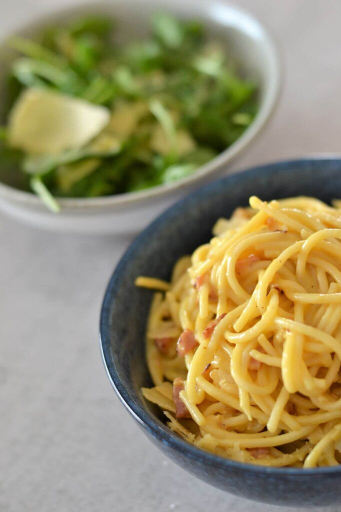 spaghetti-with-bacon-in-blue-bowl