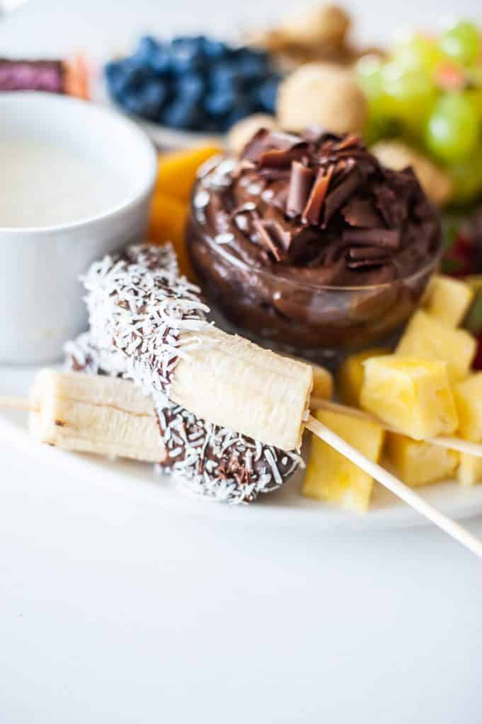 glass bowl with chocolate mousse, with banana and pineapple