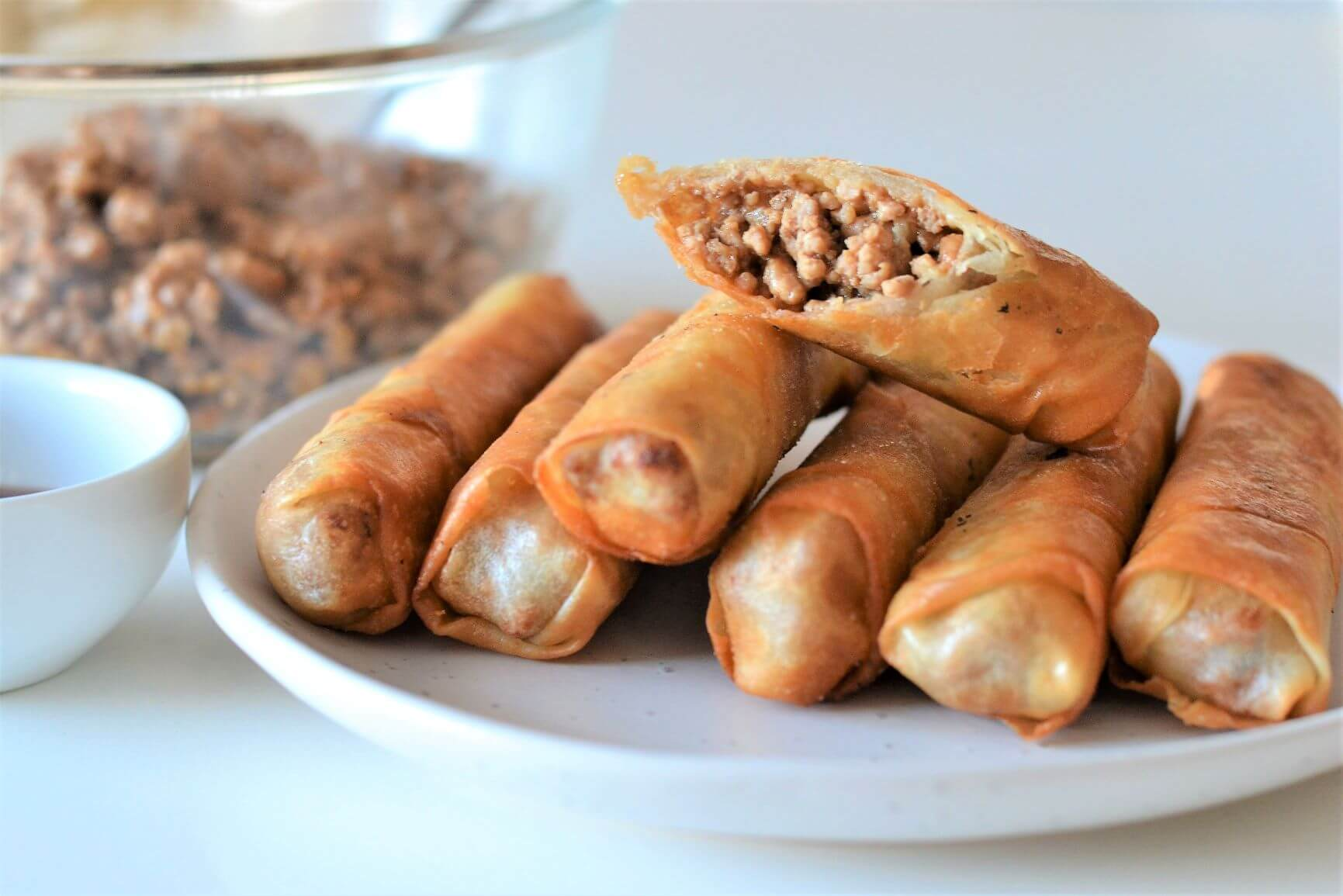 pork spring rolls on a white plate