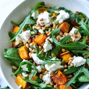 A bowl of salad with pumpkin and goats cheese
