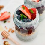 top view of chia pudding in glass jar with berries