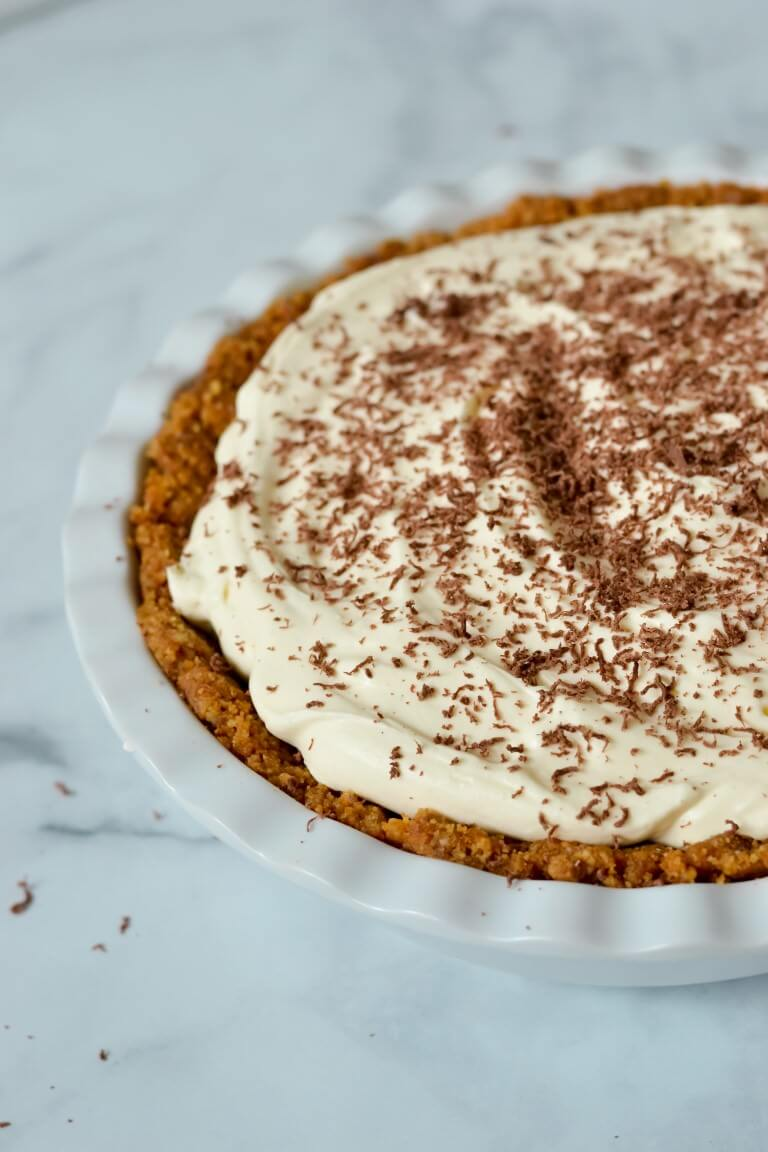 top view of finished banoffee pie in white dish