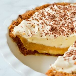side view of sliced banoffee pie in white dish