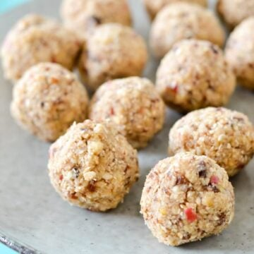 finished bliss balls on a grey plate