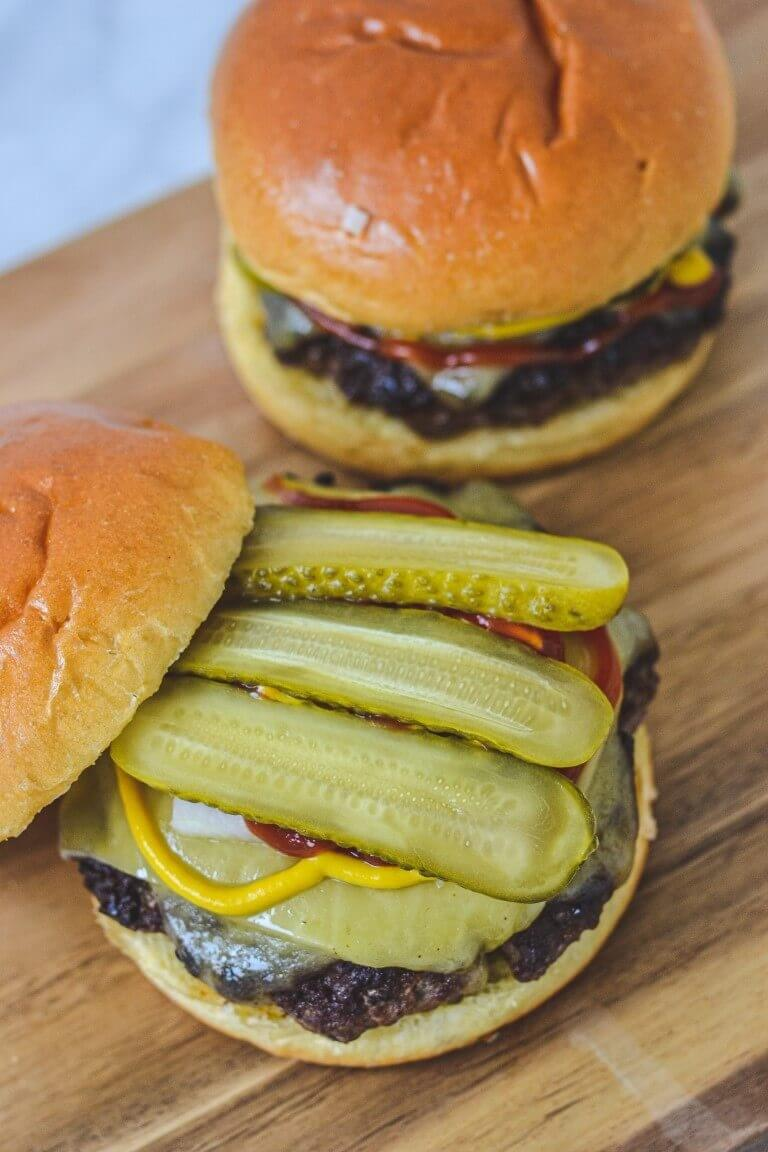 burger-topped-with-pickles-on-board