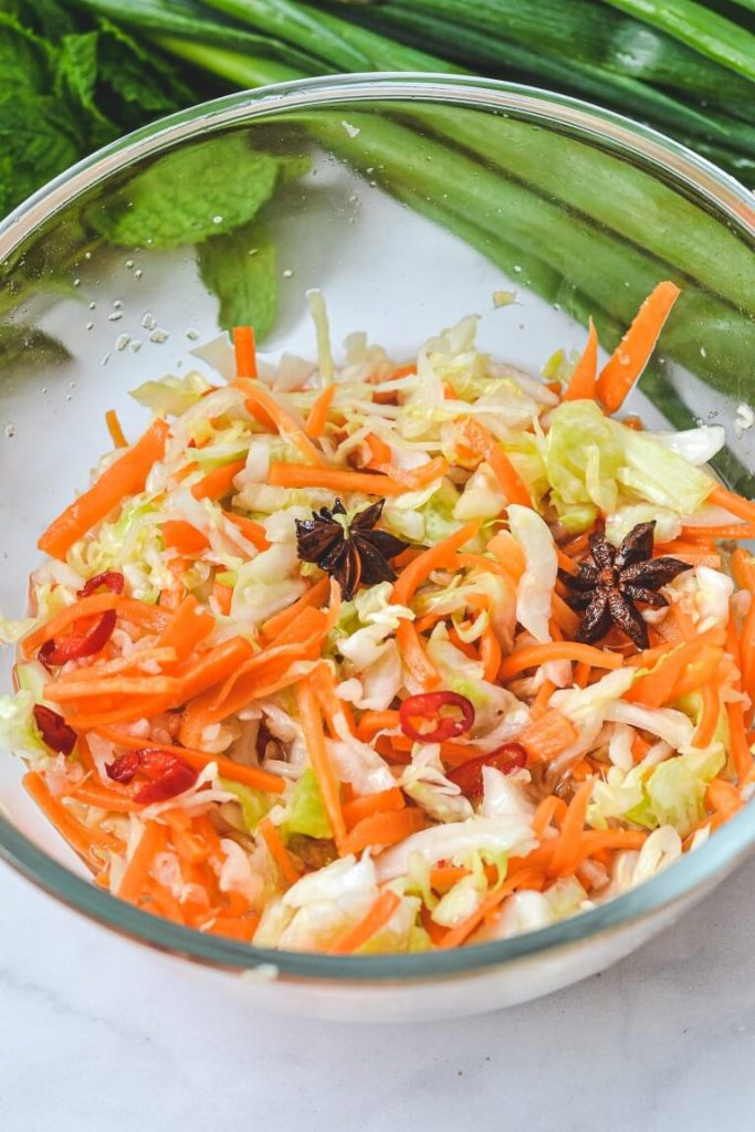 pickled vegetables with star anise in glass bowl