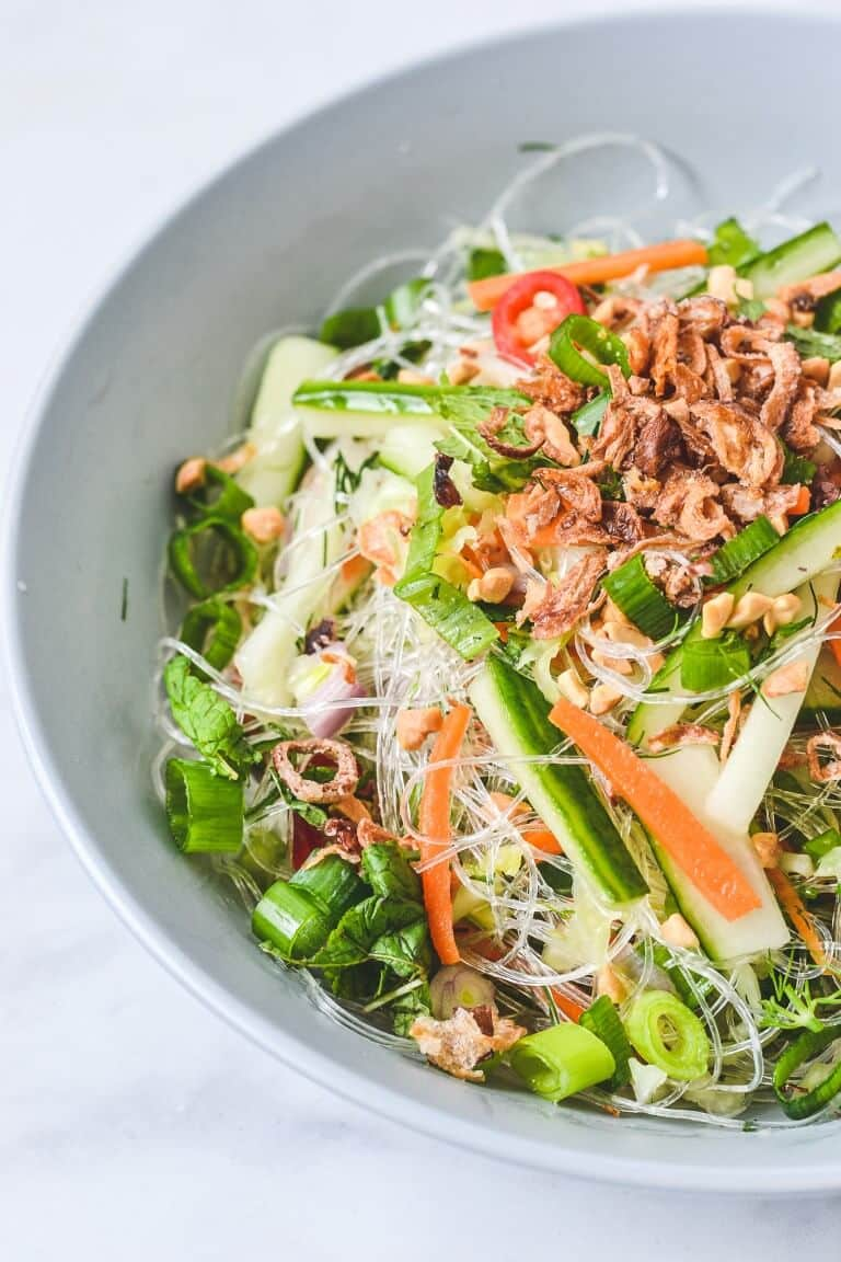 noodle salad in a bowl with cucumber and shallots