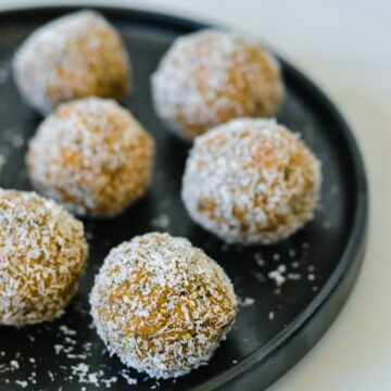 caramel-bliss-balls-on-black-plate