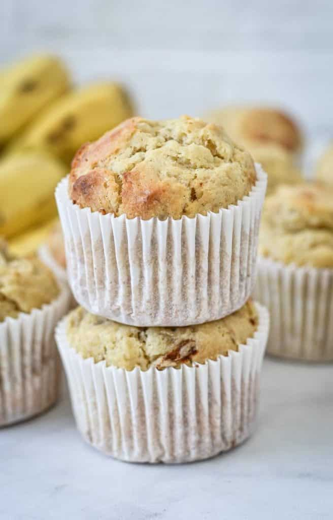 A close up of a muffins, sitting on top of another muffin