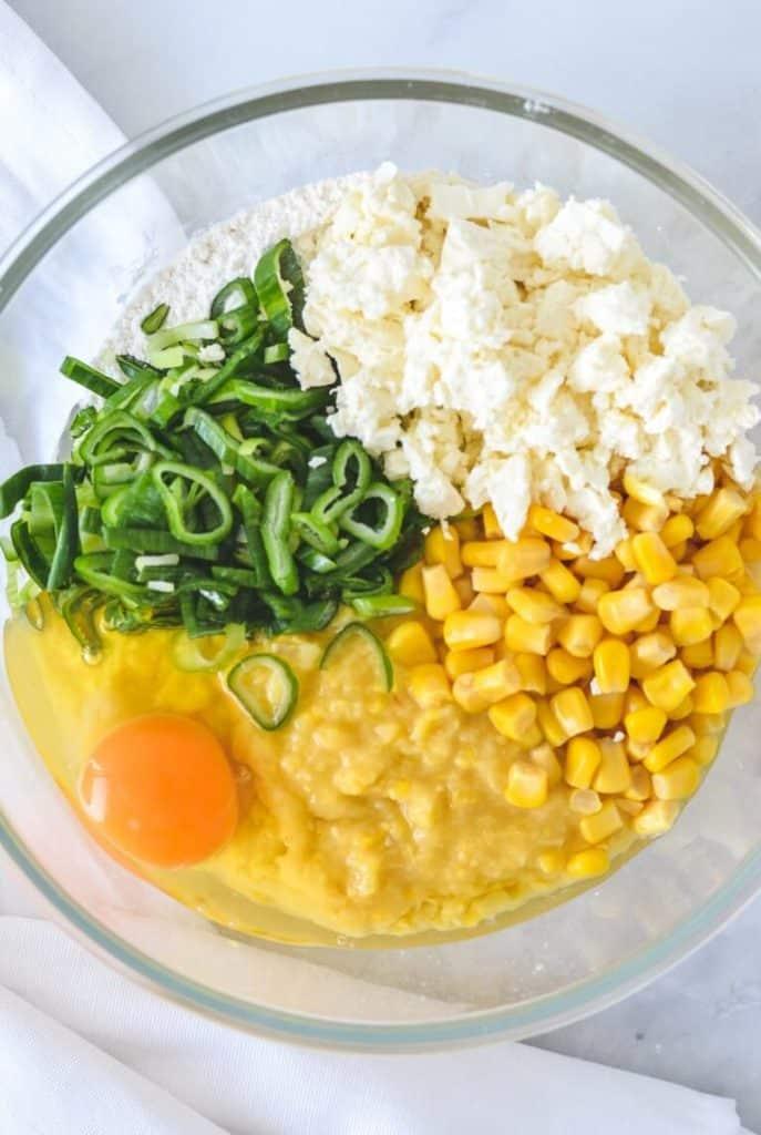 corn-feta-egg-spring-onions-flour-in-mixing-bowl
