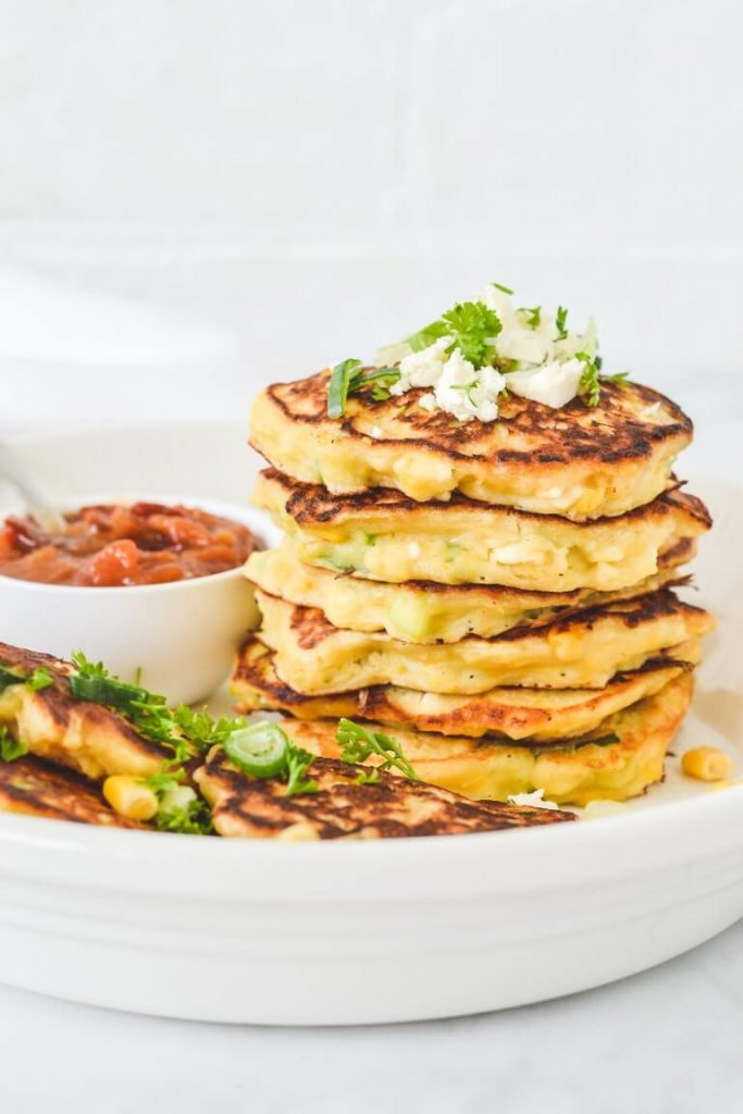 stack-of-corn-fritters-with-salsa-and-crumbled-feta