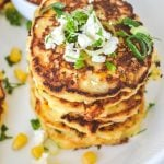 stack-of-corn-fritters-in-white-bowl