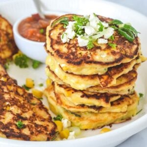 corn-fritters-sprinkled-with-feta-in-white-bowl