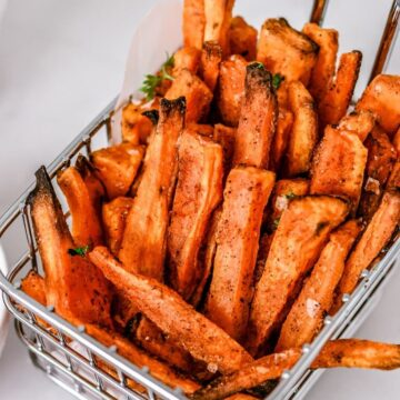 top view of finished sweet potato fries in a metal basket