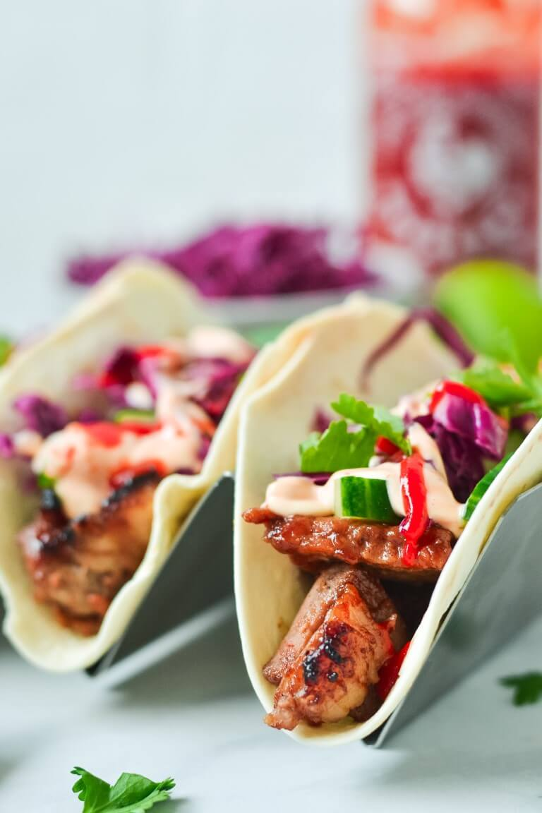close up of flour tortillas with char siu pork and cabbage