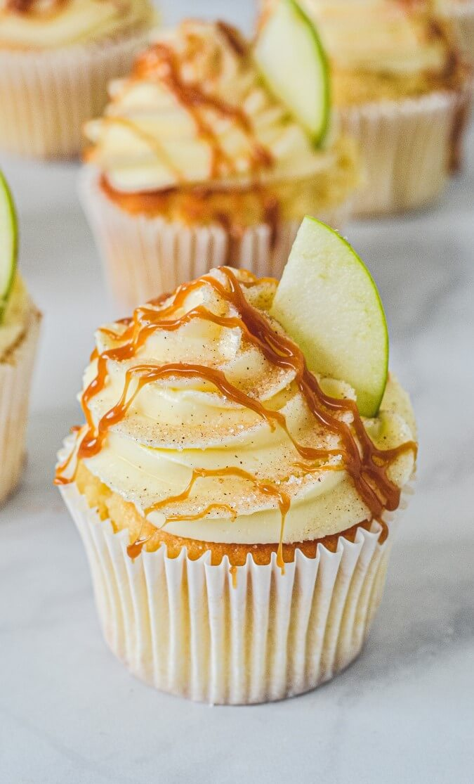 cupcake-with-cream-cheese-frosting-and-apple-wedge-on-top