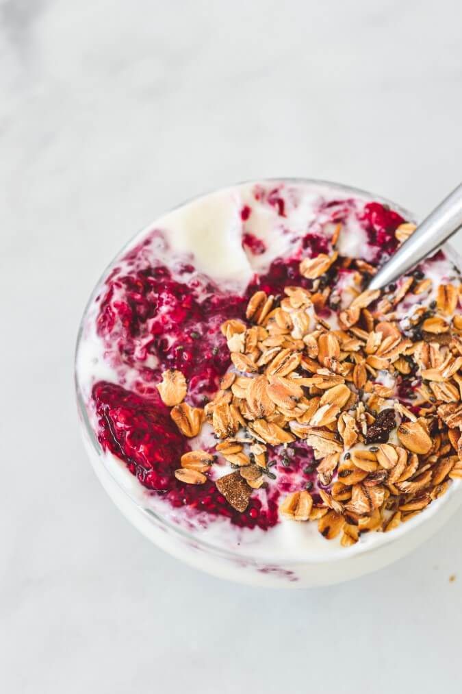 raspberry-jam-with-granola-and-yoghurt-in-glass-bowl