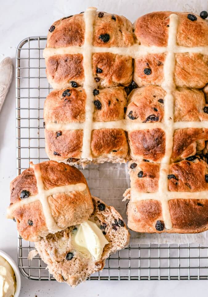 hot-cross-buns-with-butter-on-metal-rack