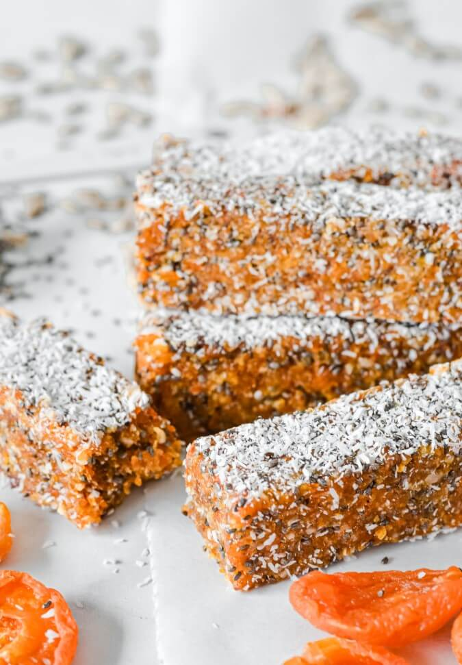 apricot-chia-bars-in-pile-with-a-broken-bar-in-front