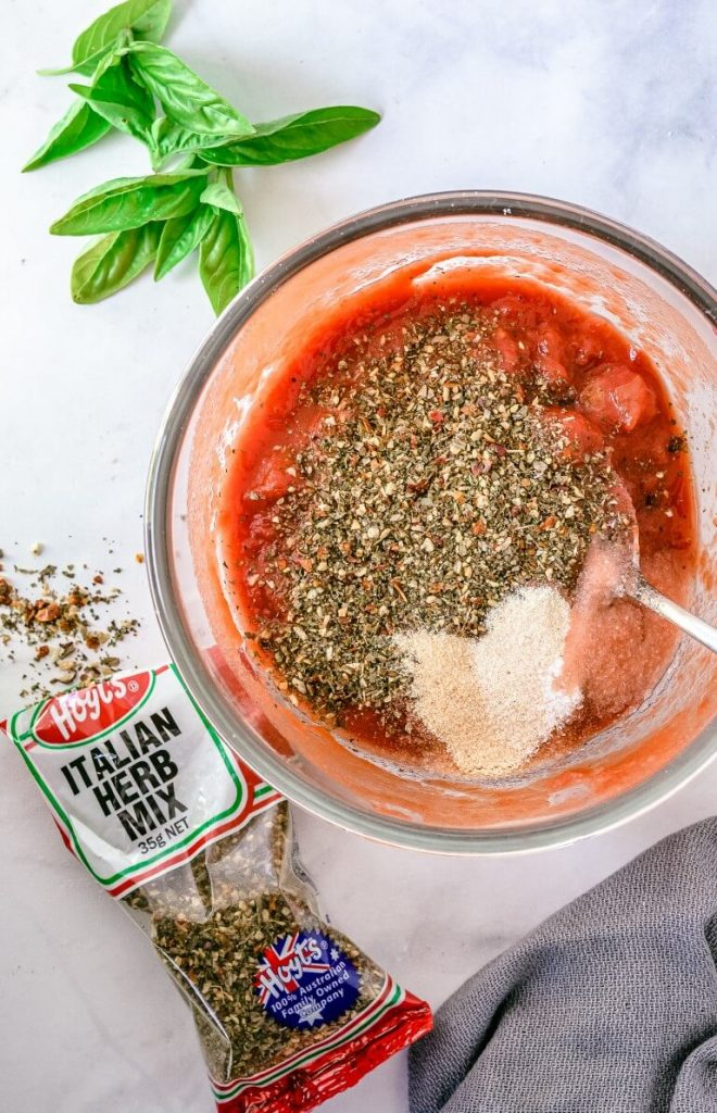 tomato paste and herbs in glass bowl