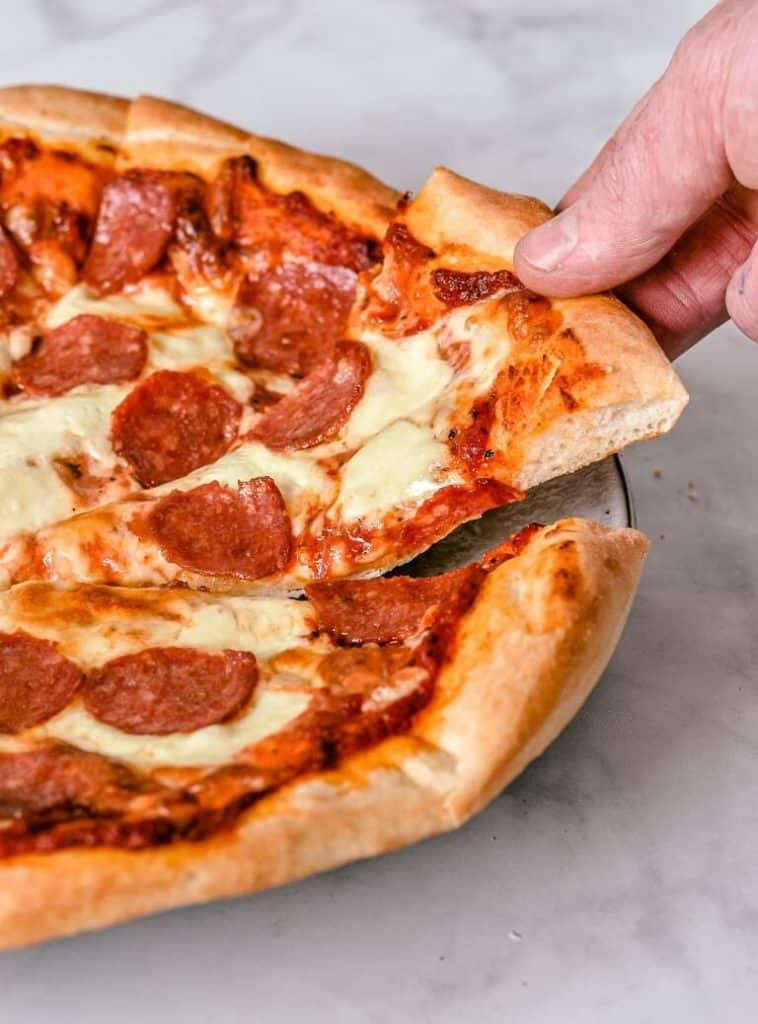 pizza-slice-being-lifted-from-pizza