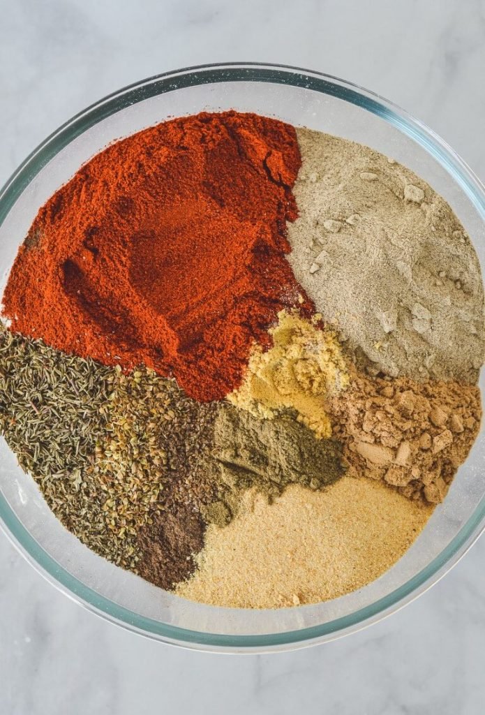 flour-and-mixed-spices-layered-in-bowl