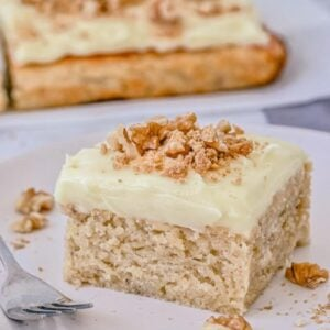 banana-cake-slice-on-plate-with-crumbled-walnuts
