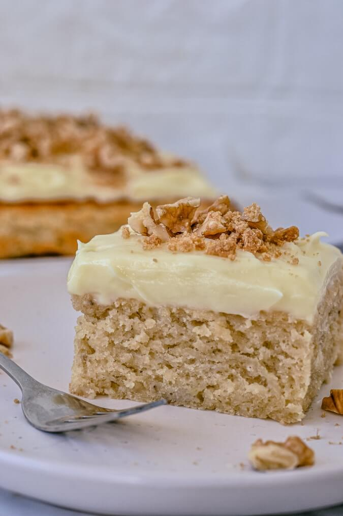 banana-cake-on-white-plate-with-fork-on-side