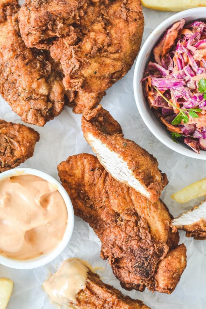 fried-chicken-on-white-board-with-coleslaw