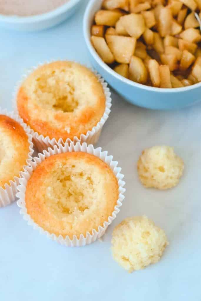 vanilla-cupcakes-with-hollowed-out-centres