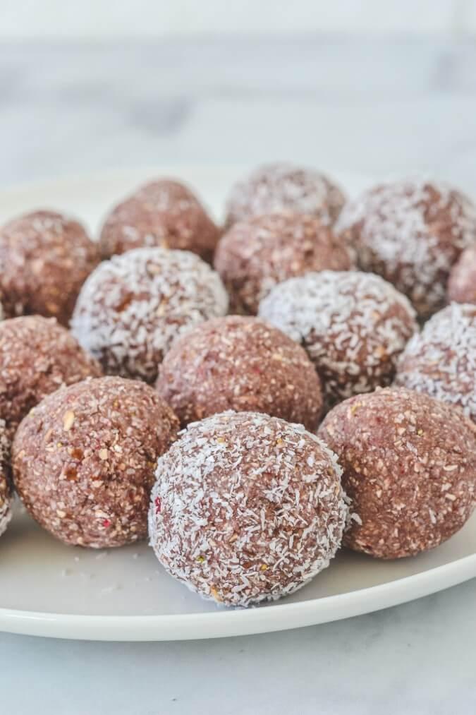 strawberry-bliss-balls-on-white-plate