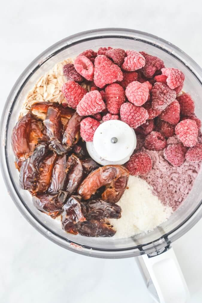 top view of raspberries and ingredients in food processor
