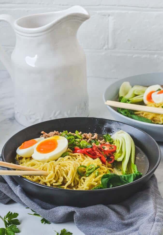 pork-ramen-and-eggs-in-black-bowl