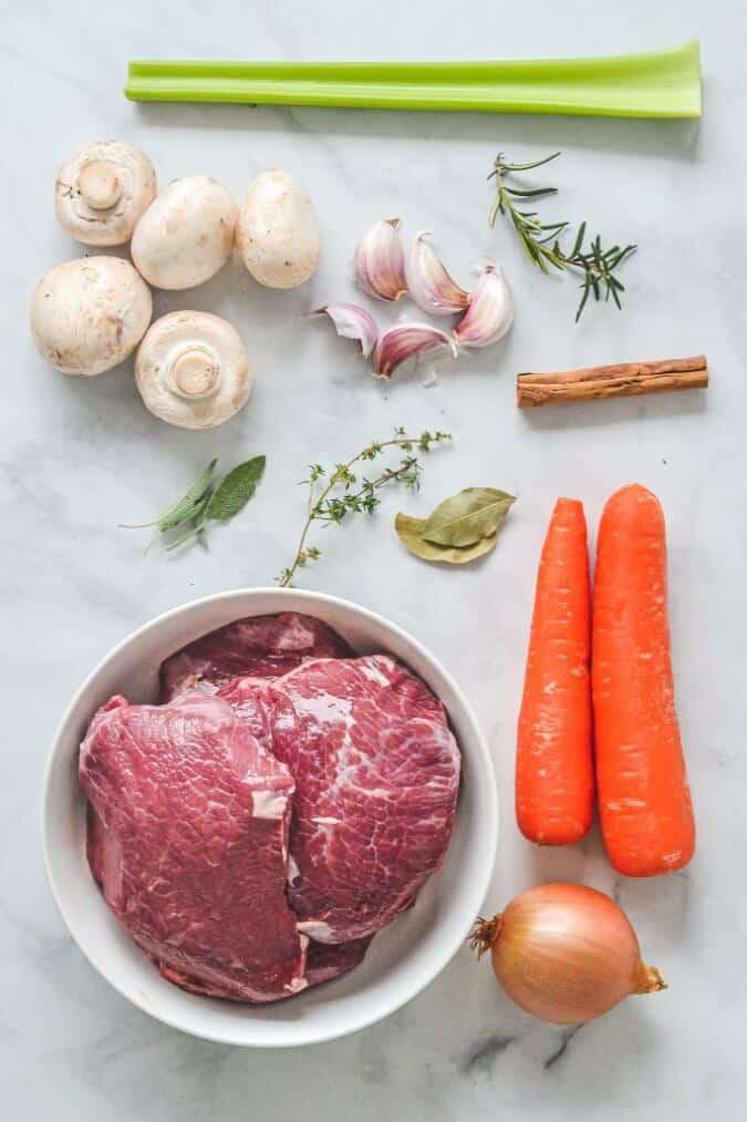 ragu-ingredients-on-white-table