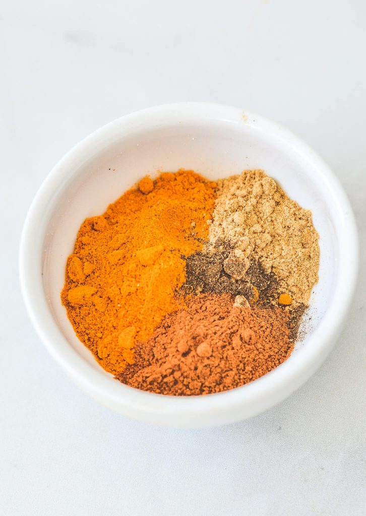 turmeric-and-ground-spices-in-white-dish