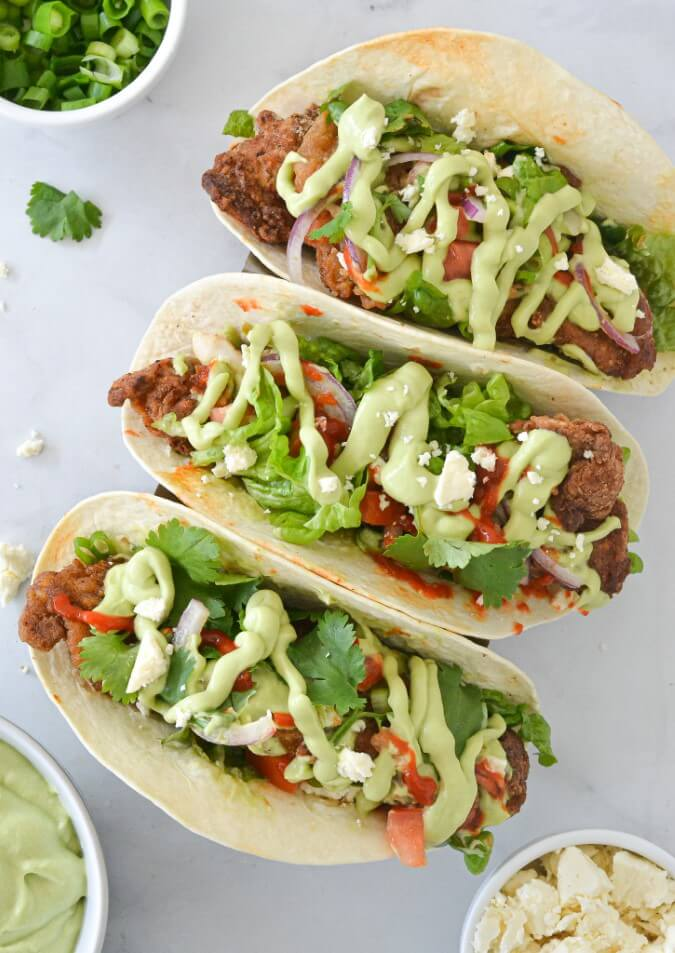 top-view-of-three-tacos-with-salad-toppings