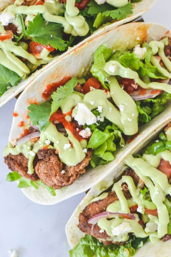 top-view-of-chicken-tacos-with-avocado-sauce