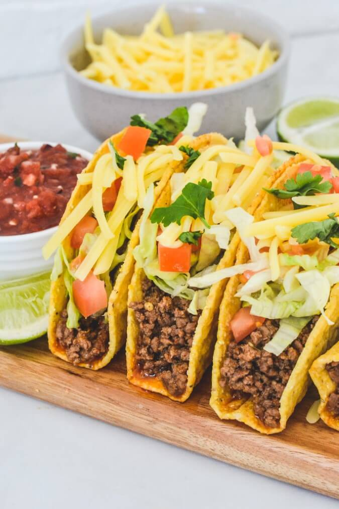 assembled-tacos-on-wooden-board
