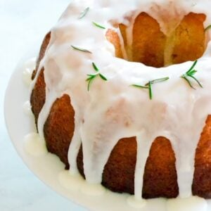 lemon-cake-on-white-stand-with-dripping-white-icing