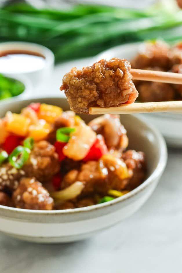 fried-battered-pork-held-in-chopsticks