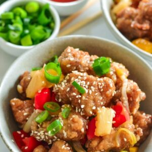 sweet-and-sour-pork-with-pineapple-in-white-bowl