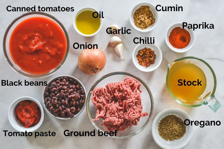 A close up of food on a table, with spices and descriptive labels
